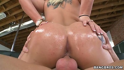 Dayna Vendetta sitting on dick  with her ass in oil riding it hard
