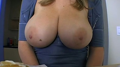 Big tits Sara Stone putting her tits on the table
