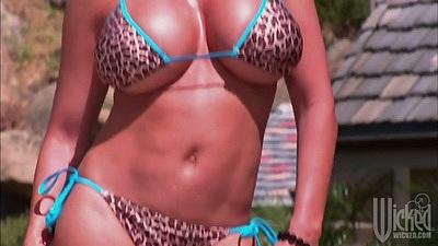 Big tits milf Diamond Foxxx in a bikini tanned outdoors looking good