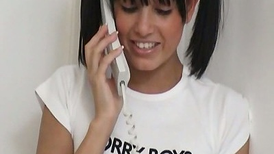 Sasha Cane talking on the phone and taking off her teen panties