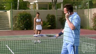 Outdoor tennis match with athletic Rayveness and a coach