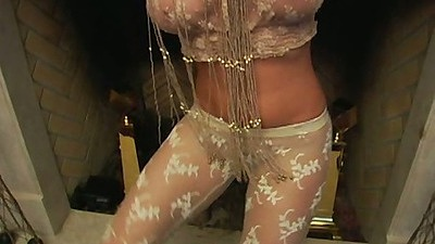 Jade wearing sexy lingerie by the fireplace undresses in solo action
