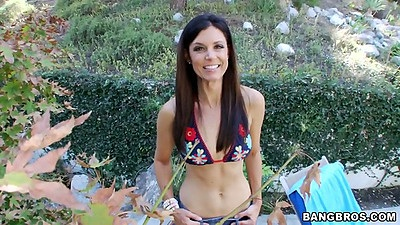 Outdoors with sexy India Summer in her bikini top and shorts