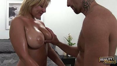 Big tits oiled up Velicity Von titty fucks and sucks dick