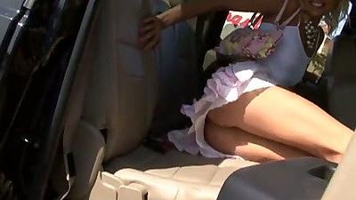 Nikki Luv in backseat giving upskirt peak
