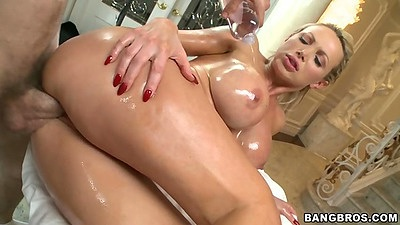 Oiled up Nikki Benz getting fuck on massage table
