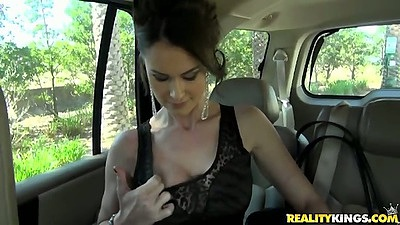 Backseat milf shows tits in a car