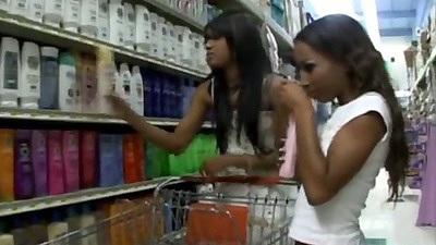 Ebony lesbians Tina and Capri go shopping in public