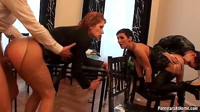 Standing fuck half dressed group orgy near dinner table