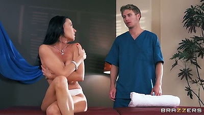 Milf Vanilla Deville goes for a massage topless in her cute panties and oil