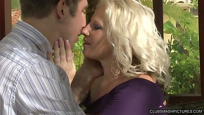 Blonde fully clothed Kimmy Olsen making out with guy and naked for blowjbo