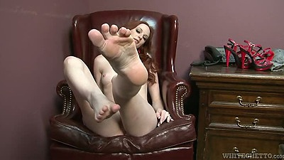 Posing with sexy feet redhead Audrey Lords gets feet licked