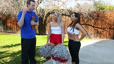 Fully clothed cheerleaders in uniform with Francesca Le and Zoey Monroe