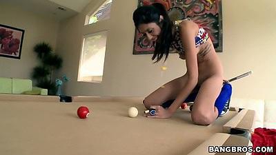 Solo cutie Angel Del Rey on pool table shooting balls