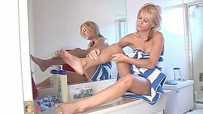 Rubbing herself with lotion Lexy Lohan on the bath table