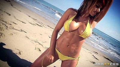 Big tits oil latina Anita Toro posing on the beach