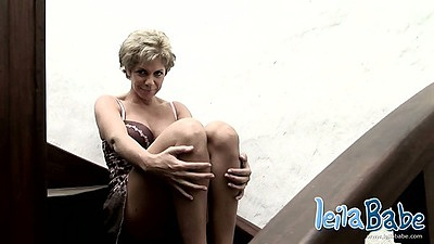 Leila Babe moving around naked on the stairs