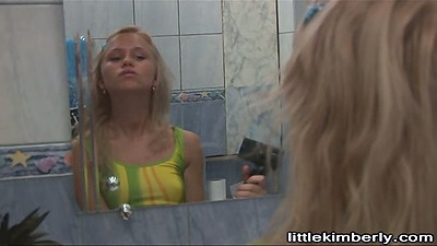 Blonde Little Kimberly sucking dildo with no panties on toilet