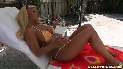 Bikini tanning with milf women outdoors