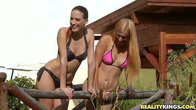 Outdoor happy jumping girls in bikinis with Mira Sunset and Lyen Parker acting like euro lesbians