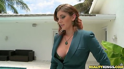 Milf Rainia Belle looking spicy in that suit with perfect mom tits