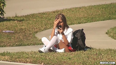 Young and innocent school girl teen Jessicka Alman doing her homework on the lawn