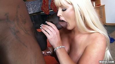 Alura Jenson sucks a huge black cock in a milf blowjob