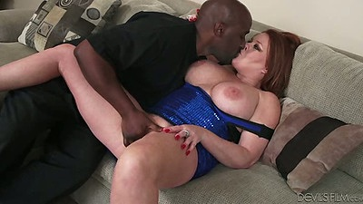 Mature slut Kate Faucett takes of a large black cock and sucks it
