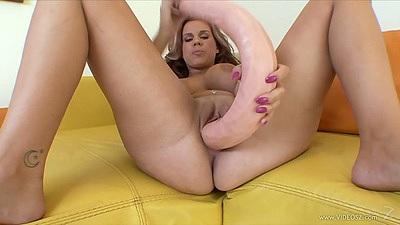 Rachel Solari and large dildo opens legs on the sofa