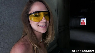 Solo skinny chick Remy LaCroix practicing her shooting at the range half naked