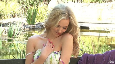 Sexy babe Sophia Knight and her solo undressing by pond