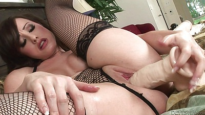 Jennifer White and her dildo in fishnet solo action