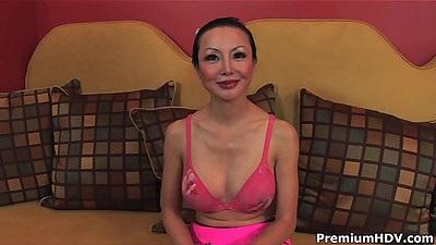 Asian milf Ange Venus is sucking it hard down