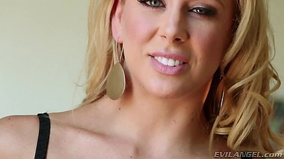 Good looking pornstar babe Cherie DeVille is wearing lingerie