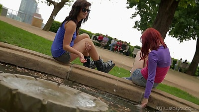 Tess and Leila redhead girls rollerblading outdoors