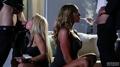 Destiny Dixon and Helly Mae Hellfire sucking cock and blowing smoke fully clothed